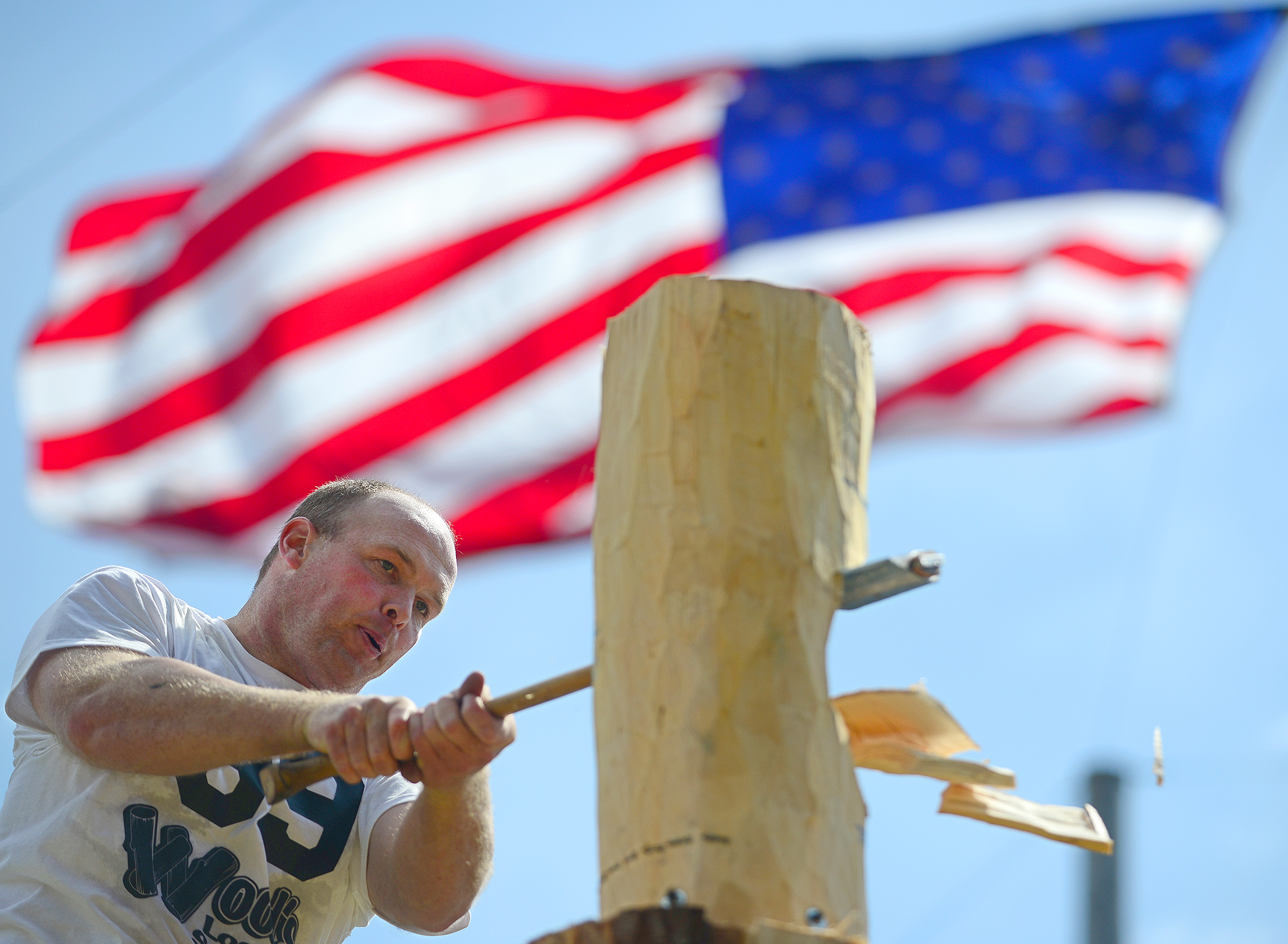 While standing on a plank nearly 7 feet off the ground, Branden Sirguy of Port Angeles chops away at a log in a heat of the springboard chop competition at the 71st Annual Loggers Jubilee in Morton, Wash. on Saturday, Aug. 10, 2013. Dozens of competitive loggers from across the Northwest traveled to Morton this weekend to battle for the title Bull of the Woods. Loggers competed in up to 13 events, including axe throwing, speed climbing, and birling.