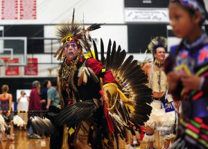 J.C. Allen-Tackett, Silverdale, dances during an intertribal dance at the Cowlitz Indian Tribe's 14th Annual Pow-Wow at Toledo High School on Saturday afternoon.
